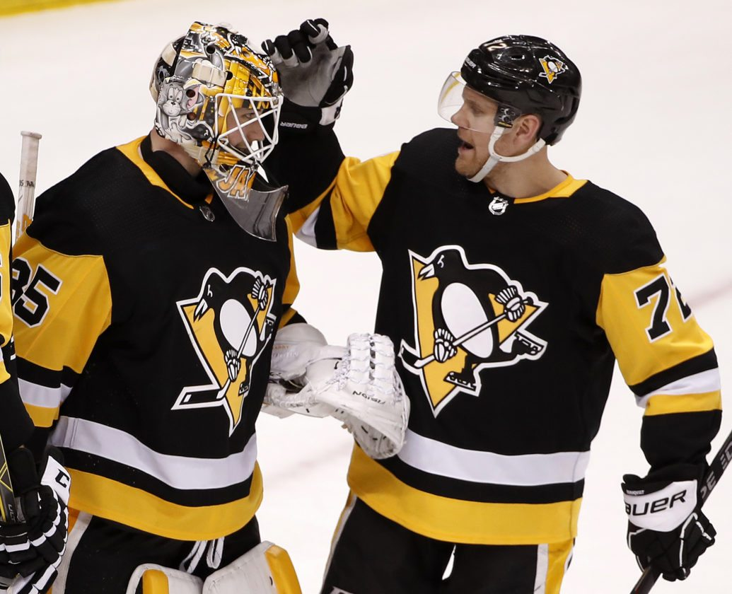 Pittsburgh Penguins goaltender Tristan Jarry (35) celebrates with Patric Hornqvist (72) after getting a 4-1 win over the Detroit Red Wings in an NHL hockey game in Pittsburgh, Saturday, Jan. 13, 2018. (AP Photo/Gene J. Puskar)