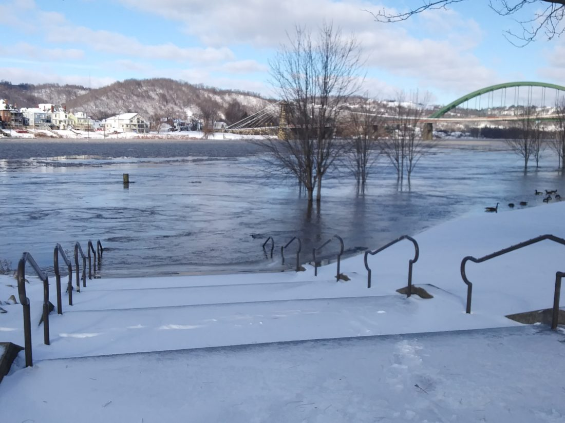 Photo by Ian Hicks Top, High water covers Wheeling's Heritage Port as the Ohio River rose steadily throughout the day Saturday.
