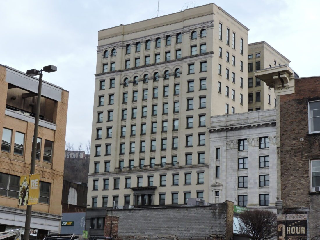 Photo by Casey Junkins A developer plans to spend about $20 million transforming the former Wheeling-Pittsburgh Steel headquarters on Market Street into a mixed-use complex with as many as 100 residential units and some retail space.