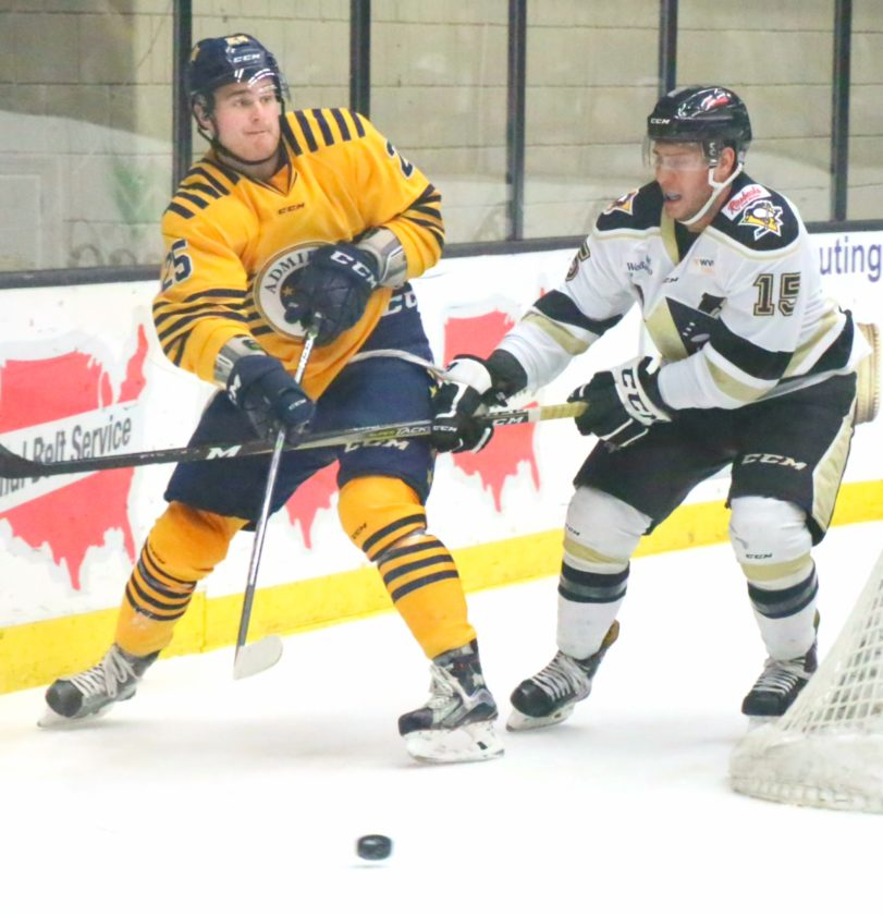 Photo by Joe Lovell Wheeling's Chris Francis (right) and Norfolk's T.J. Melancon battle for position during Saturday's ECHL game at WesBanco Arena.