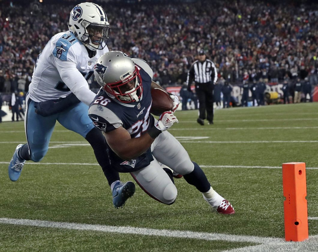 New England Patriots running back James White, right, runs past Tennessee Titans safety Kevin Byard (31) for a touchdown during the first half of an NFL divisional playoff football game, Saturday, Jan. 13, 2018, in Foxborough, Mass. (AP Photo/Charles Krupa)