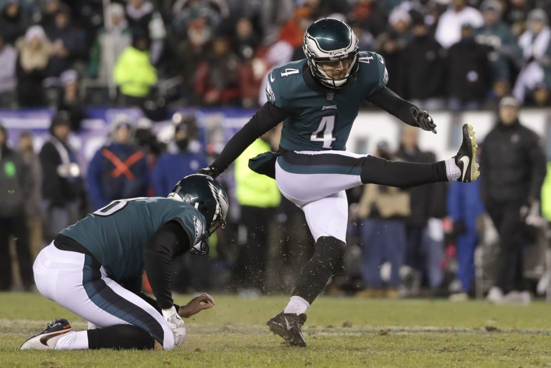 Philadelphia Eagles' Jake Elliott, right, kicks a field goal as Donnie Jones holds during the first half of an NFL divisional playoff football game against the Atlanta Falcons, Saturday, Jan. 13, 2018, in Philadelphia. (AP Photo/Michael Perez)