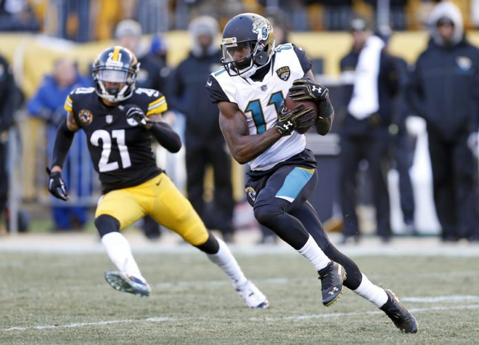 Jacksonville Jaguars wide receiver Marqise Lee (11) runs after catching a pass from quarterback Blake Bortles during the second half of an NFL divisional football AFC playoff game in Pittsburgh, Sunday, Jan. 14, 2018. (AP Photo/Keith Srakocic)