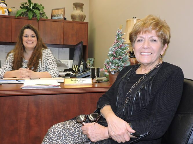 """Retiring Wheeling City Clerk Janice Jones, right, who will record her final city council meeting Tuesday, works Friday with new Clerk  Brenda """"B.J.""""  Delbert.    Photo by Casey Junkins"""