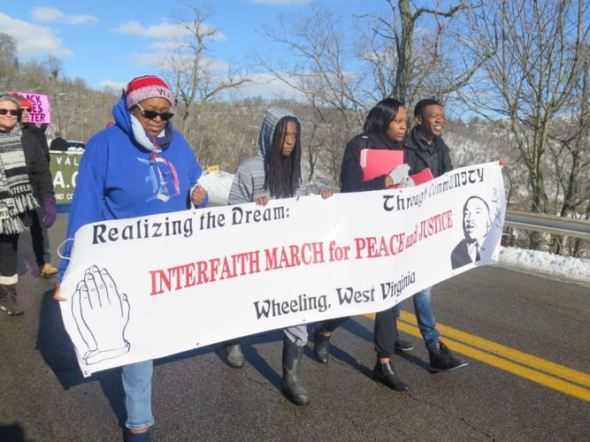 Photo by Joselyn King Students representing Wheeling Jesuit University's Black Student Union march down Wheeling Hill during the Interfaith  March For Peace And Justice Sunday. The event was one of among many set to commemorate Martin Luther King Jr. weekend by WJU and faith-based community partners.