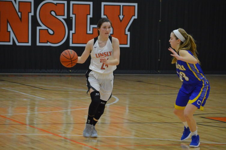 Photo by Cody Tomer Linsly's Molly Heron pushes the ball up the floor against Steubenville Central during Monday night's game at Stifel Fieldhouse inWheeling.