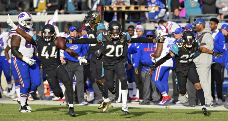 Jacksonville Jaguars outside linebacker Myles Jack (44), cornerback Jalen Ramsey (20) and defensive back Tyler Patmon (23) celebrate Ramsey's interception of a pass from Buffalo Bills quarterback Nathan Peterman intended for wide receiver Deonte Thompson in the second half of an NFL wild-card playoff football game, Sunday, Jan. 7, 2018, in Jacksonville, Fla. (Bob Mack/The Florida Times-Union via AP)