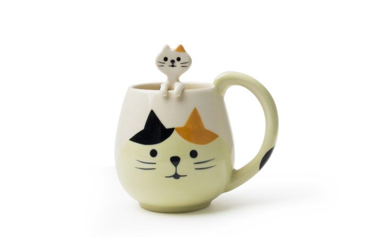 This undated photo shows a mug from Miya Company. Cats are a popular motif in Asian tableware, symbolizing good luck. This mug comes with its own little kitten spoon. (Miya via AP)