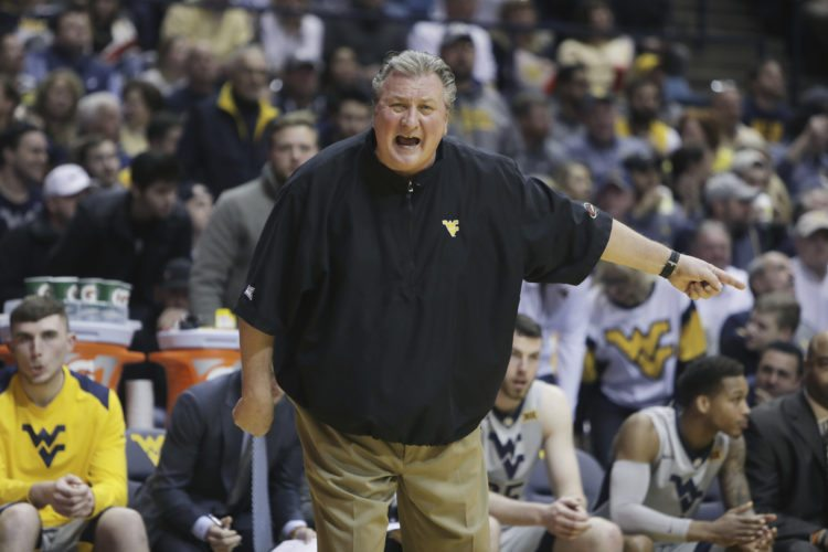 West Virginia head coach Bob Huggins screams directions to his players during the first half of an NCAA college basketball game against Kansas Monday, Jan. 15, 2018, in Morgantown, W.Va. (AP Photo/Raymond Thompson)