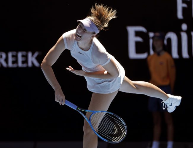 Russia's Maria Sharapova serves to Germany's Tatjana Maria during their first round match at the Australian Open tennis championships in Melbourne, Australia, Tuesday, Jan. 16, 2018. (AP Photo/Vincent Thian)