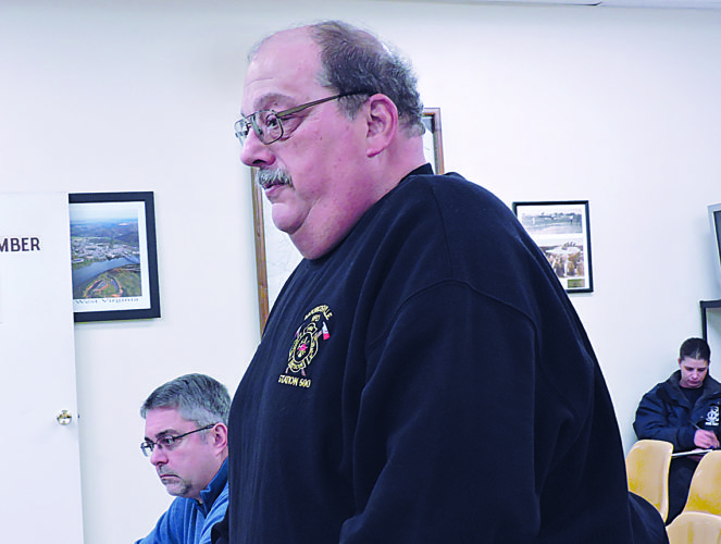 Photo by Alan Olson Moundsville Volunteer Fire Department Chief Brad Varlas extends the offer to host the city's municipal fire department at their First Street facility during a city council meeting Tuesday.