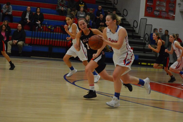 Photo by Cody Tomer Wheeling Park's Laurel Robb, right, races the ball up the court, while Bellaire's Maci Crozier gives chase Wednesday night.