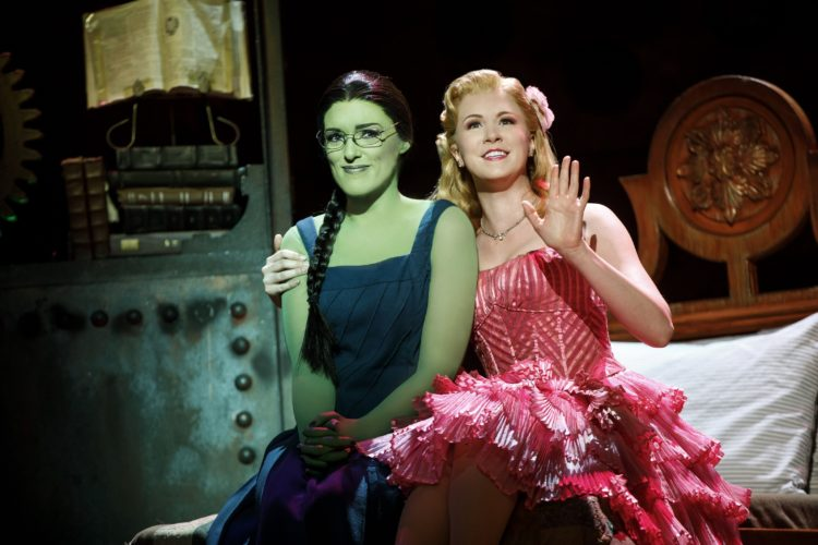 "Mary Kate Morrissey as Elphaba and Ginna Claire Mason as Glinda in ""Wicked."""