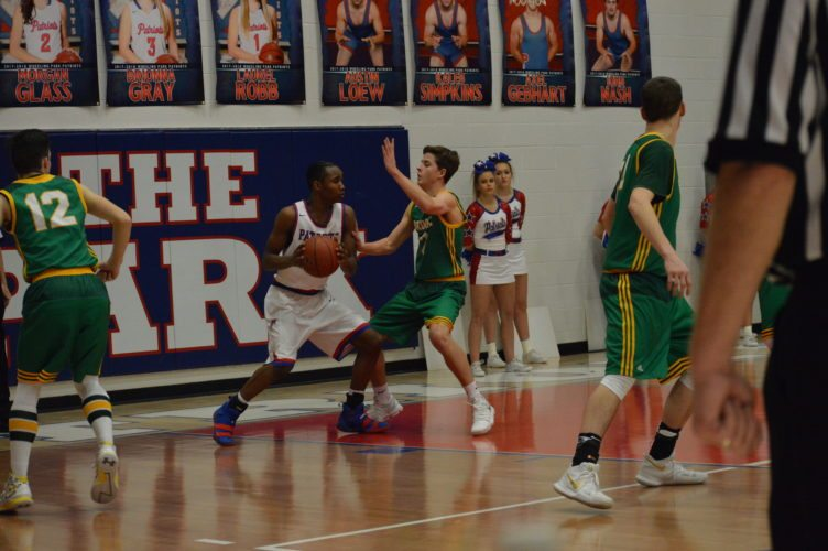 Photo by Kyle Lutz Wheeling Park's Keondre' King looks to score while Brooke's Justin Shelton defends.