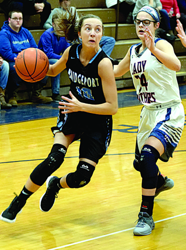 Photo by Seth Staskey Bridgeport's Marissa Beal, left, goes to the basket against Buckeye Local's Alaire Destifanes.
