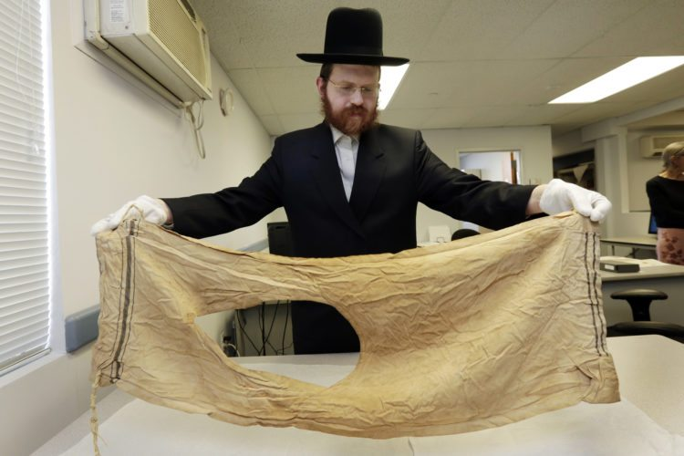 Dovid Reidel,   director of Research and Archive Division of the Amud Aish Memorial           Museum, in        Brooklyn, N.Y., holds a talit, or prayer shawl, part of the museum's collection, that belonged to Mendel Landau, in 1944, of Auschwitz, Poland.  The museum        focuses on Jewish religious practice and the role of faith during the              Holocaust.  AP Photo