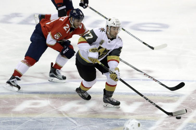 Vegas Golden Knights' Brad Hunt (77) skates with the puck as Florida Panthers' Vincent Trocheck (21) pursues during the first period of an NHL hockey game Friday, Jan. 19, 2018, in Sunrise, Fla. (AP Photo/Lynne Sladky)