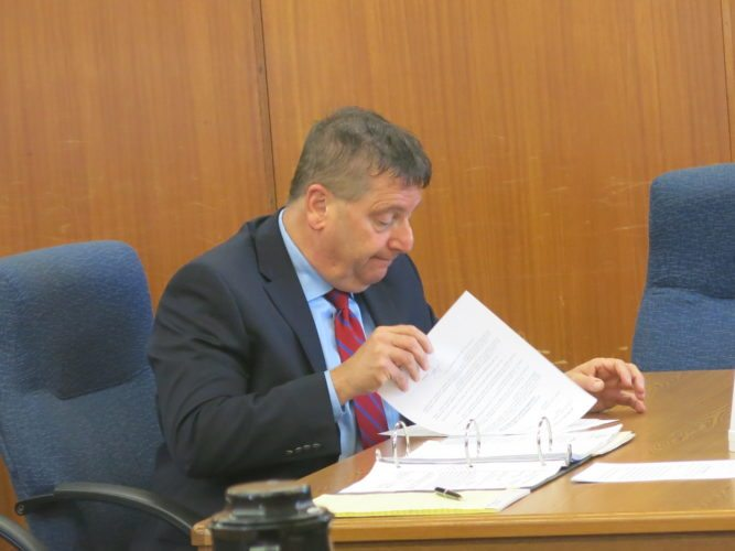 Photo by Jessica Broverman Belmont County Commissioner Mark Thomas reviews documents Friday in Ohio County Circuit Court.