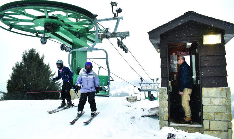 Photo by Scott McCloskey Oglebay Park employee Michael            Hajdukovich operates the lift at the top of the hill near the ski lodge.
