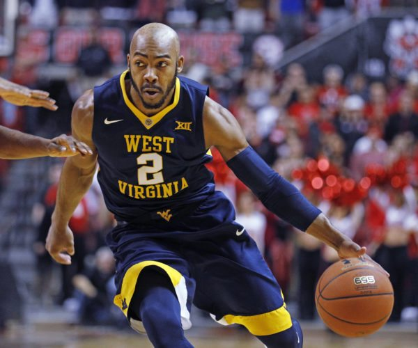 West Virginia's Jevon Carter (2) dribbles the ball down the court during the first half of an NCAA college basketball game against Texas Tech, Saturday, Jan. 13, 2018, in Lubbock, Texas. (AP Photo/Brad Tollefson)