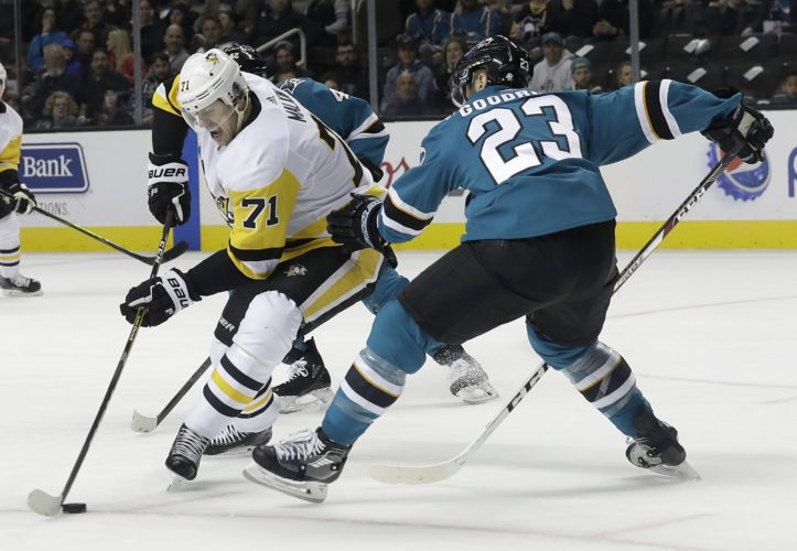 Pittsburgh Penguins center Evgeni Malkin (71), from Russia, skates against San Jose Sharks right wing Barclay Goodrow (23) during the first period of an NHL hockey game in San Jose, Calif., Saturday, Jan. 20, 2018. (AP Photo/Jeff Chiu)