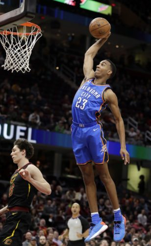 Oklahoma City Thunder's Terrance Ferguson (23) dunks the ball in the second half of an NBA basketball game against the Cleveland Cavaliers, Saturday, Jan. 20, 2018, in Cleveland. (AP Photo/Tony Dejak)
