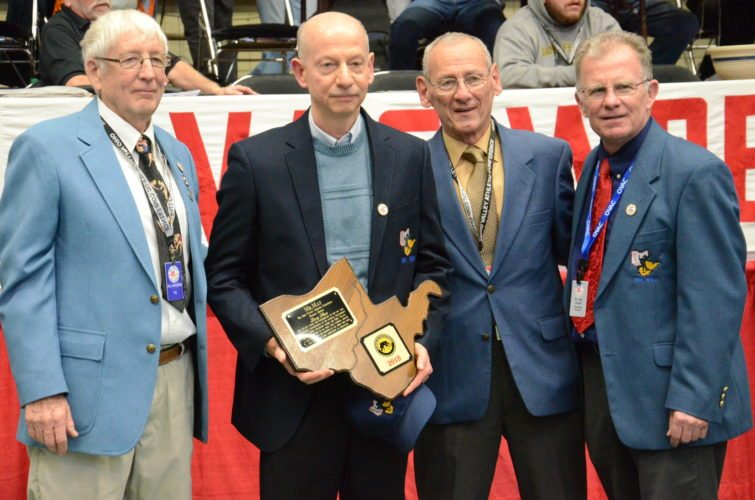 Photo by Kim North Former Oak Glen coach Larry Shaw, second from left, is shown receiving the Mr. Mat award. Shown, from left, are Ron Mauck, Shaw, former Oak Glen coach Vince Monseau and tournament director Dan Doyle.