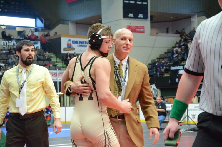 Photo by Kim North John Marshall's Anthony Carman, left, is congratulated by Monarchs coach Ted Zervos after winning the 160-pound championship, beating Parkersburg South's Zane Hinzman, 2-1, in overtime.