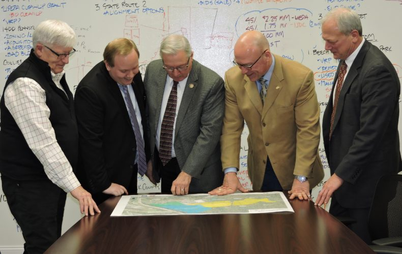 Looking over plans for the new Park Drive  Development, from left, are  Business  Development Corp. of the Northern  Panhandle  Assistant Director Marvin Six,  Weirton City  Manager Travis  Blosser, Weirton Mayor Harold Miller, BDC Executive Director Pat Ford and Eric Frankovitch of Park Drive  Development LLC.  Photo by Craig Howell