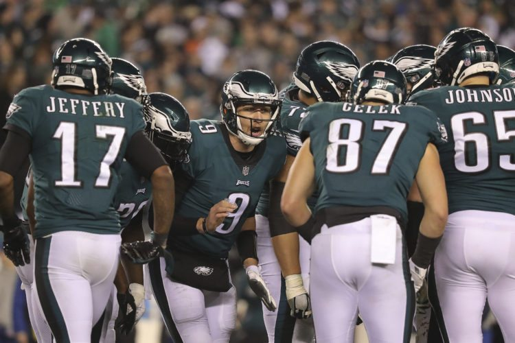 Philadelphia Eagles quarterback Nick Foles talks with his teammates in the huddle during the fourth quarter against the Minnesota Vikings in the NFC championship NFL football game Sunday, Jan. 21, 2018, in Philadelphia. The Eagles won 38-7. (David Maialetti/The Philadelphia Inquirer via AP)