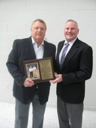 Photo by Seth Staskey Long-time Steubenville Central assistant football coach Frank Spence, left, was inducted to the Ohio Valley Football Coaches Association's Assistant Coaches Hall of Fame on Sunday afternoon at Steubenville High School. Presenting the award is former Crusaders head coach Gregg Bahen.