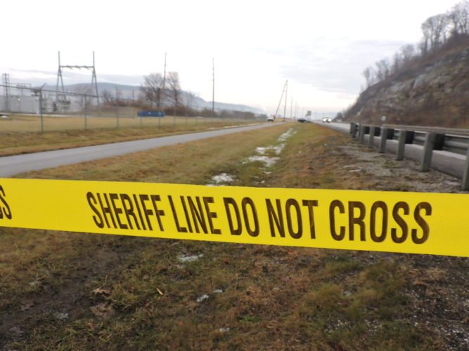 Photo by Casey Junkins  Tape blocks the portion of the Wheeling Heritage Trail near the location that Ohio County Sheriff deputies located a body on Sunday.