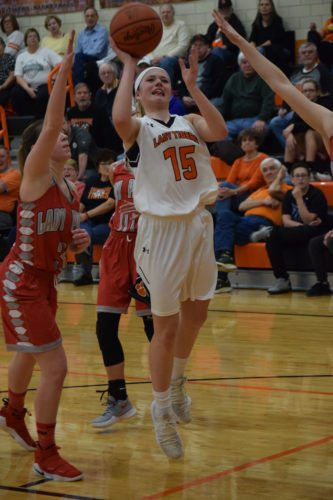 Shadyside freshman Baylee Wach (15) lifts a shot as River's Alli Long defends Monday in Shadyside.         Photo by  Seth Staskey