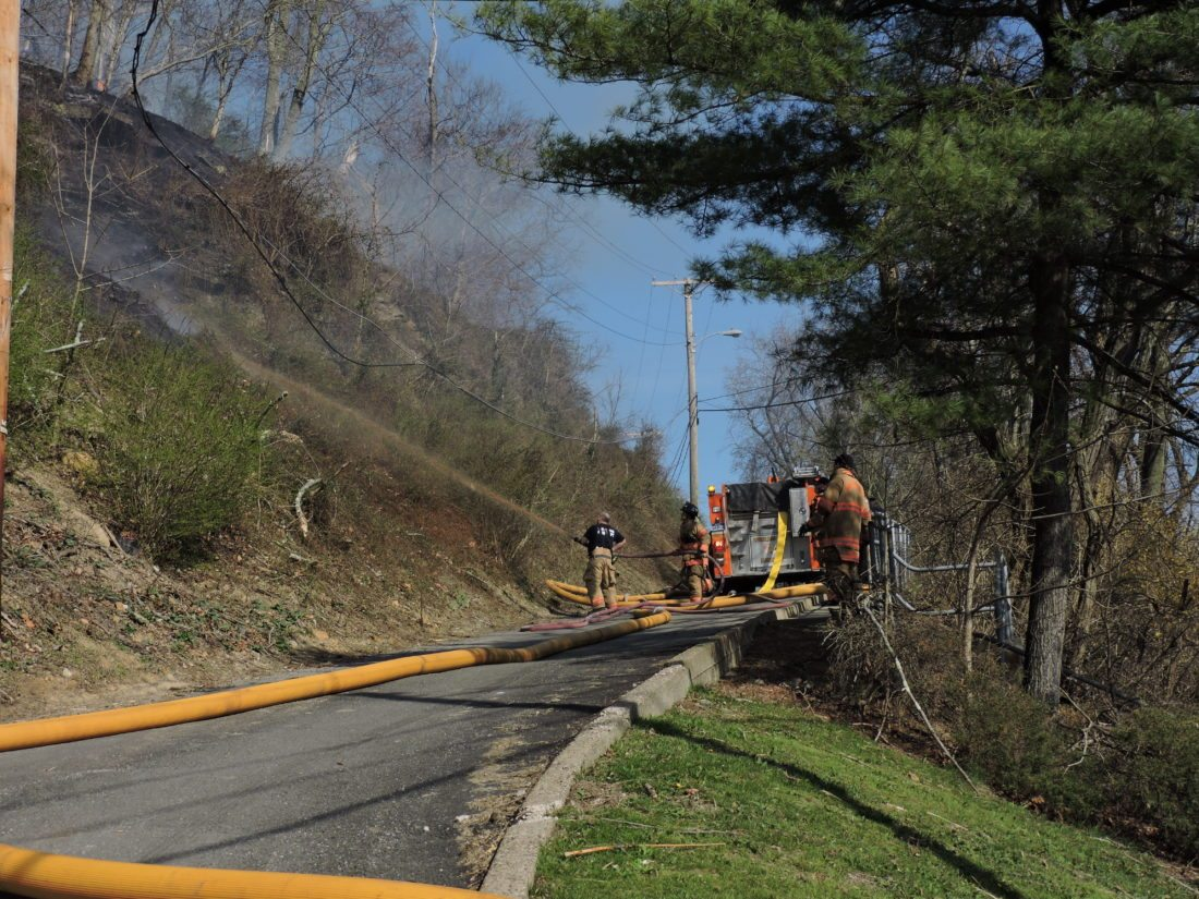 Brush fire spreads to garage, quickly extinguished