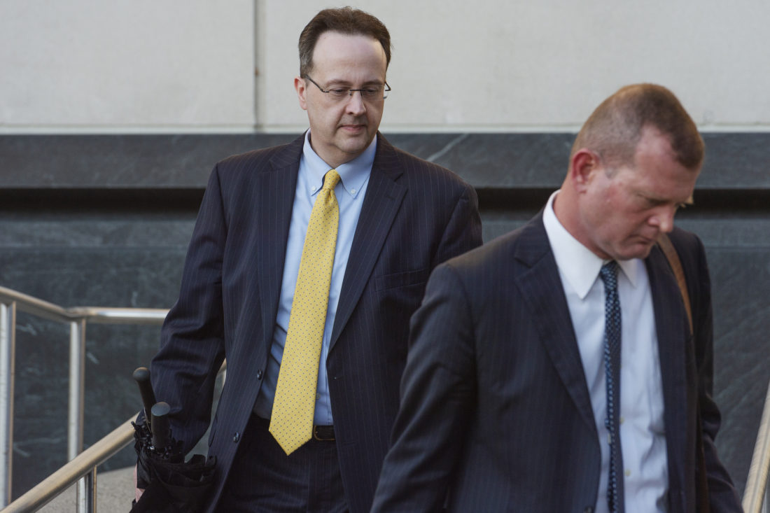 west virginia supreme court justice allen loughry emerges with his lawyer john carr from the robert c byrd united states courthouse after a federal jury