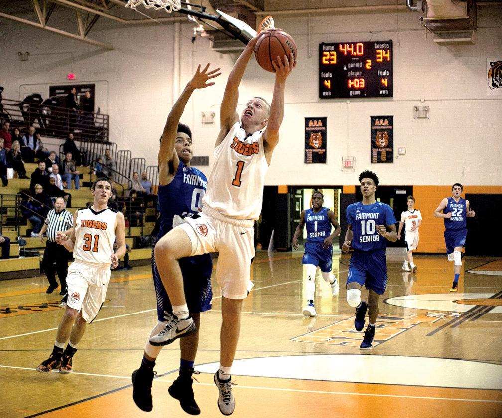 The Inter-Mountain photo by Kevin Hostetler Elkins senior point guard Dalton Hamrick drives to the basket Tuesday against Fairmont Senior