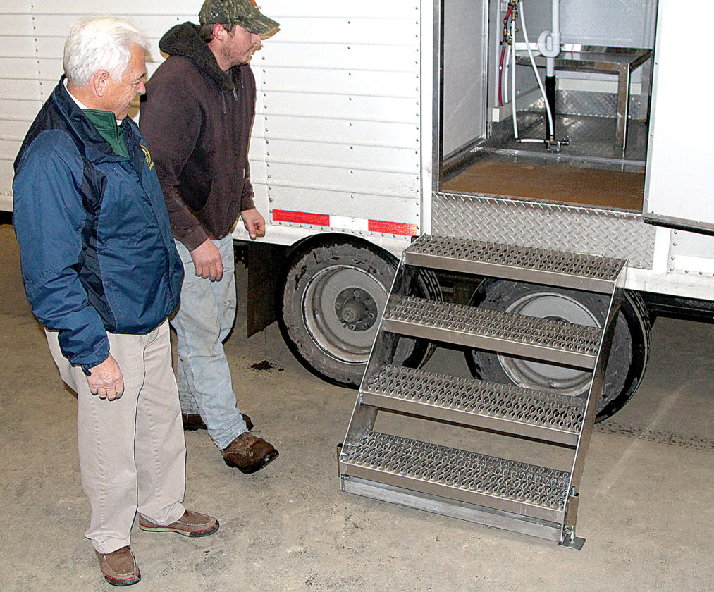 Commissioner of Agriculture Walt Helmick is on hand this week at the Huttonsville State Farm to check out West Virginia's first mobile processing unit, which will allow growers to process their own poultry, rabbits and fish and potentially boost that portion of the state's agricultural production.