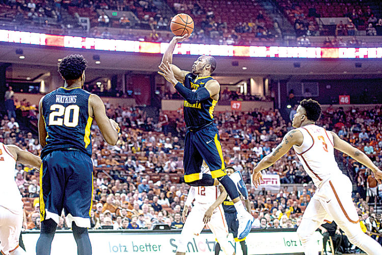 Jevon Carter hits two of his 15 points in the second half of WVU's 74-72 victory over Texas in Austin.