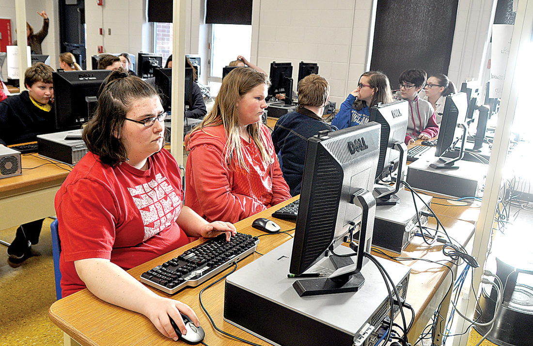 Eighth-grade student Amberlyn Sears, front left, and other students at Buckhannon-Upshur Middle School are taking part in a popular after-school program called Project ISAAC.