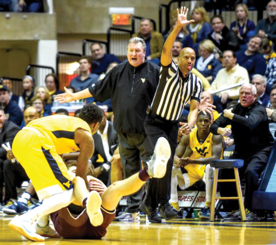 WVU coach Bob Huggins disagrees with a call during a recent game in Morgantown.