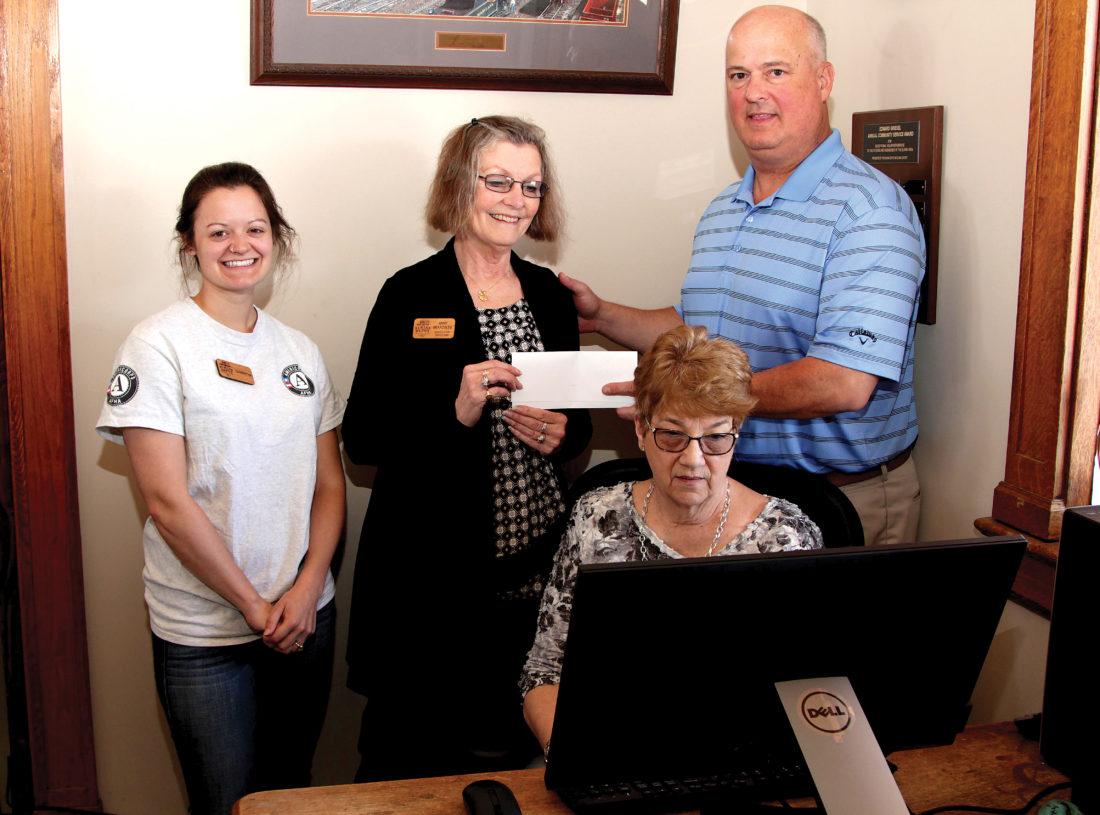 Elkins Depot Welcome Center Executive Director Anne Beardslee accepts a check from Snowshoe Foundation Board Member Voras K. Haynes, Jr.