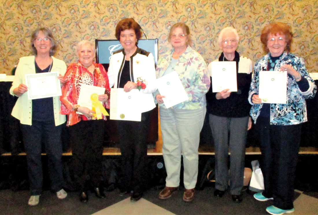 Members of the Emma Scott Garden Club accept several awards from the West Virginia Garden Club Inc. The annual state convention recently took place at The Greenbrier in White Sulphur Springs. From left are Julia Cassells, B.J. McKenzie, Judy Guye Swanson, Becky Amorese, Virginia Cassells and Rachel Pingley.