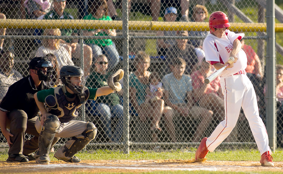 The Inter-Mountain photos by Kevin Hostetler A Tygarts Valley Bulldogs batter puts wood on the ball during the team's exciting 6-5 win over Notre Dame in the Class A Region II Section 1 championship Thursday. The Bulldogs had to beat Notre Dame twice in a row to earn the title.