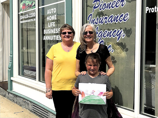 Pioneer Insurance agent Shelly Kerns, left, and Elkins Main Street Executive Director Karen Carper pose for a photograph with Third Ward Elementary School student Laiken McCauley Thursday afternoon in downtown Elkins. McCauley's artwork was chosen to appear on the T-shirts for the annual Mountains Beckon Bicycle Parade & Rodeo, which is scheduled for Saturday. Registration for the annual event is set for 9 a.m. in the City Hall parking lot. The bicycle parade will start at 10 a.m., with the rodeo following at Joey's Bike Shop on Third Street. The first 30 registrants age 12 and under will receive a free T-shirt, compliments of Pioneer Insurance, and a coupon for a kid's ice cream cone from the Market Creamery at the Delmonte Market. Participants are invited to decorate their bicycles, and prizes will be awarded following the event. Judges for this year's contest will be Elkins Mayor Van Broughton, Randolph County Commissioner Mark Scott and AmeriCorps member Samantha Hellman. For additional information, call Elkins Main Street at 304-637-4803.