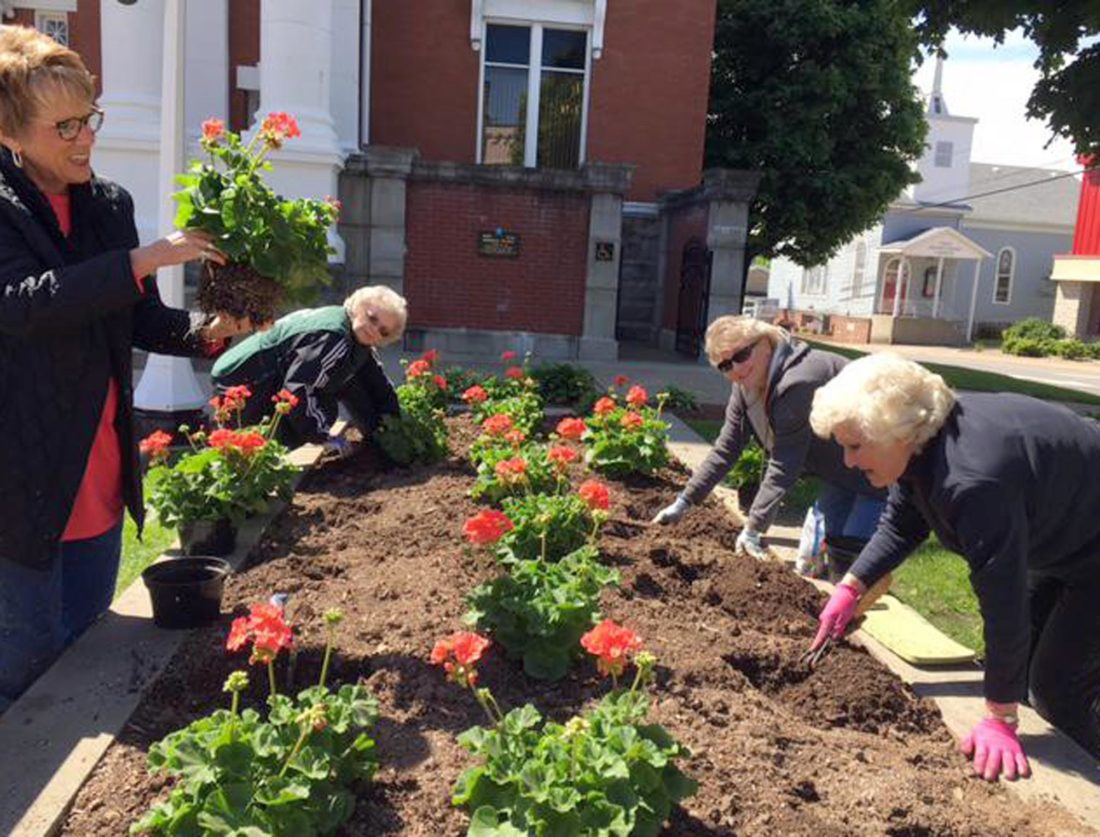 Submitted photo Fred Brooks Garden Club members, from left, Libby Randall, Sandra McCutcheon, Cindy Phillips and Helen Heater complete sprucing up the courthouse flower beds May 5. Prior to this planting, all the old plants had been pulled from the beds by club members, assisted by county maintenance staff and new dirt purchased by the club added to build them up. The new, salmon-colored geraniums, also purchased by the club, were then planted. The county maintenance staff maintains the beds after planting. Other flower beds that the club will be working on include the health department, Fred Brooks Park and Blue Star Memorial Highway markers. New for this year, at the request of the Upshur County Historical Society, the Historical Society Museum flower beds will be redesigned and planted by club members in the near future. For more information on the Fred Brooks Garden Club, call Patty McComas at 304-472-7941.