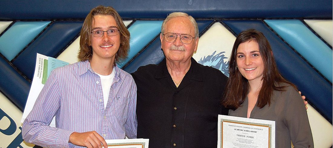 Submitted photo Jorey Carpenter, left, and Tristen Furby are the Barbour County Chamber of Commerce Academic Scholars for 2017. The awards were presented by Chamber President Reg Trethen, center.