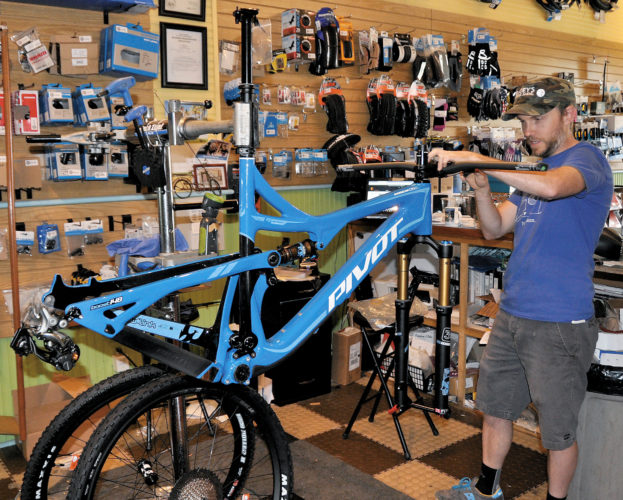 The Inter-Mountain photo by Angelea Goodwin Joey Riddle, owner of Joey's Bike Shop in downtown Elkins, tunes up a customer's ride for the upcoming bike season.