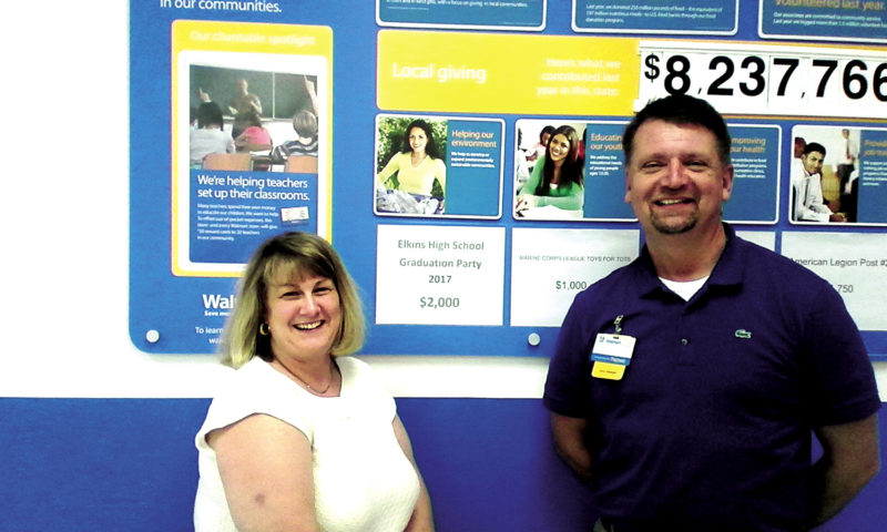 Submitted photo GFWC Junior Woman's Club President Angie Goff, left, accepts a $2,000 donation from Elkins Wal-Mart Store Manager David Kesling. The funds will be used for the Elkins High School Project Safe Graduation Party, set for Friday.