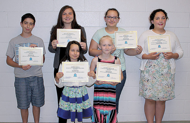The Inter-Mountain photo by Brooke Binns Young Writers contest winners were recognized during the Upshur BOE meeting on Tuesday. Pictured are, front row from left, Sophia Brown and Catalena Kennedy; and second row from left, Carter Glover, Hannah Eshelman, Alexis Lee and Julianna Stark.