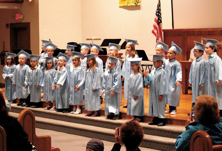 The Inter-Mountain photo by Brooke Binns Shining Light Learning Center celebrated the graduation of their four-year-old class on Wednesday evening with a program filled with songs performed by the graduates. Pictured includes Mylah Hutson, Jackson Friddle, Khole Hawkins, Sadie Wright, Justin Kyle, Alys Elmore, Lily Perry Elijah Smith, Kaylee Long and Mason Pudder; and back row from left, Claire Bennett, Isaiah Shreve, Grace Fletcher, Wes-lynn Anderson, Cooper Warner, Aiden Latham, Samuel Belan, Liam Ruddle and Daniel Channell.